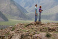 Man woman altai landscape nature young couple caucasian guy and girl among the summer looking at the beautiful summer mountain Stock Photos