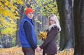 Man and a woman in the autumn park lovers male female walking Stock Photography