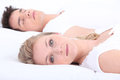 Man and woman in bed women with eyes open Stock Image