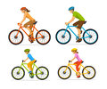 Man , woman, boy and girl riding sport bikes. Family outdoor activity