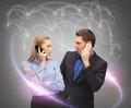 Man and woman calling with smartphones Royalty Free Stock Images