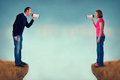 Man and woman conflict concept women with bullhorn crevasse Royalty Free Stock Image