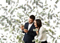 Man and woman counting money excited laughing businessman businesswoman standing under dollar s rain Royalty Free Stock Image