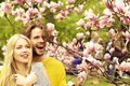 Man and woman, couple in love in spring magnolia flowers Royalty Free Stock Photo