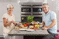 Man Woman Couple Making Sandwiches in Kitchen Royalty Free Stock Images