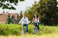 Man and woman cycling in summer Royalty Free Stock Photo