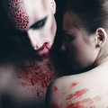 Man and woman in the dark women with blood body art Stock Images