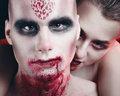 Man and woman in the dark women with blood body art Stock Photo