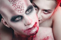 Man and woman in the dark women with blood body art Stock Photography