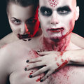 Man and woman in the dark women with blood body art Stock Photos