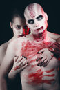 Man and woman in the dark women with blood body art Royalty Free Stock Photo