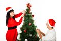 Man and woman decorating Christmas tree Royalty Free Stock Photos
