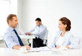 Man and woman discussing something in office smiling businesswoman businessman Royalty Free Stock Photos
