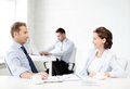 Man and woman discussing something in office smiling businesswoman businessman Royalty Free Stock Image
