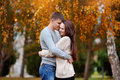 Man and woman embracing in autumn park Royalty Free Stock Photo