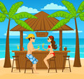 Man and woman enjoyig summer vacation, drink cocktails at beach bar Royalty Free Stock Photo