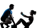 Man woman exercising abdominal workout fitness one caucasian couple men women personal trainer coach silhouette studio isolated on Royalty Free Stock Photos