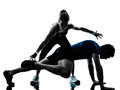 Man woman exercising legs workout fitness one caucasian couple men women personal trainer coach silhouette studio isolated on Royalty Free Stock Image