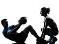 Man woman exercising weights workout fitness ball one caucasian couple men women personal trainer coach silhouette studio isolated Royalty Free Stock Image