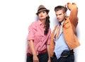 Man and woman fashion models looking away