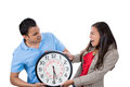 Man and woman fighting over time guy wants some space and time to himself but girl wants him to spend time with her closeup Royalty Free Stock Image