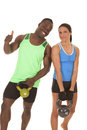 Man and woman fitness her more weight a men a women are smiling holding some weights Royalty Free Stock Photos