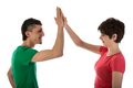 Man and woman giving a high five women isloated on white Stock Photography