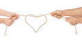 Man and woman hands with heart shaped rope Royalty Free Stock Photo