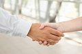 Man and woman handshake isolated on business background Stock Photos