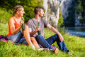 Man and woman having break hiking at river Royalty Free Stock Photo