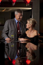 A Man and a Woman Having Drink in  a Bar Royalty Free Stock Photography