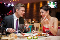 Man and woman having a romantic meal couple in love on dinner in restaurant Stock Photography