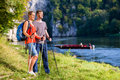 Man and woman hiking at Danube river in summer Royalty Free Stock Photo