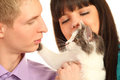 Man and woman hold cat isolated Royalty Free Stock Images