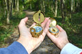 Man and woman holding compasses Royalty Free Stock Photo