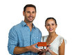 Man and woman holding house model Royalty Free Stock Photo