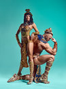 The man, woman in the images of Egyptian Pharaoh and Cleopatra Royalty Free Stock Photo