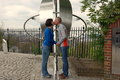 Man and woman kissing being on opposite sides of the prime meridian in greenwich women london uk Royalty Free Stock Images