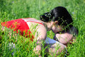 Man and woman lie on the grass and kissing focus on grass young couple lying in Stock Photography