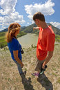 Man woman nature landscape young couple caucasian men and among the looking at the beautiful with mountains river sky and clouds Stock Photos