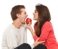 Man and woman offers the men an apple Stock Photography
