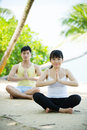 Man and Woman performing yoga. Royalty Free Stock Photography