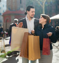 Man and woman with purchases at street smiling men women Stock Photos