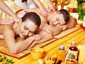 Man and woman relaxing in spa. Stock Images