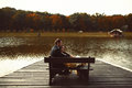 Man and woman rest on the bench at the lake Royalty Free Stock Photo
