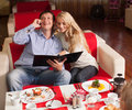 Man and woman in restaurant choose menu young couple sitting cafe women Royalty Free Stock Photos