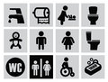 Man woman restroom vector black icons set on gray Stock Photos
