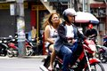 A man and a woman riding in tandem on a motorcycle in Antipolo City.
