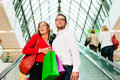 Man and woman in shopping mall Royalty Free Stock Photos
