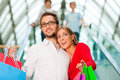 Man and woman in shopping mall Stock Image
